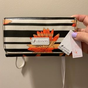 sakroots wallet with crossbody and wristlet strap